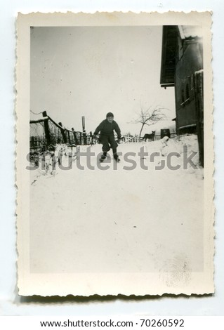 Vintage unretouched photo of boy skiing - stock photo