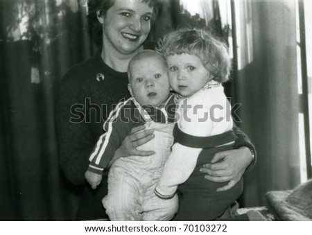 Vintage unretouched photo of mother with young children - stock photo