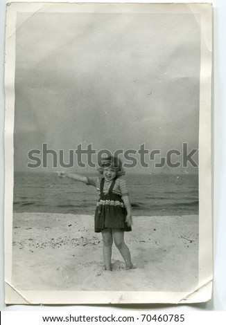 Vintage unretouched photo of young girl on beach - stock photo