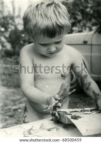 Vintage unretouched photo of young girl painting outdoor