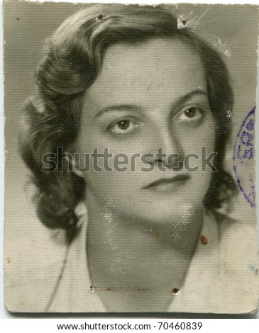 Vintage unretouched photo of young woman (fifties) - stock photo
