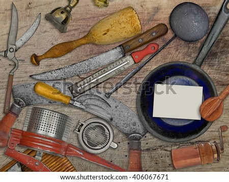 vintage utensils set for cooking over wooden table, blank business card for your text - stock photo