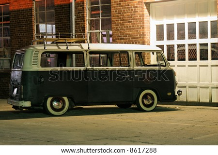 Vintage Van in front of garage door. Horizontal