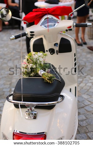 Vintage Vespa scooter with bouquet - stock photo