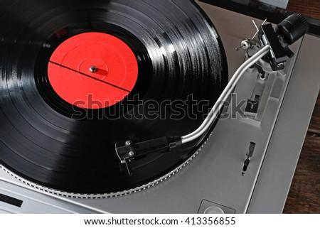 Vintage vinyl player with vinyl record - stock photo