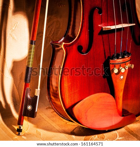 Vintage violin and bow in still life concept