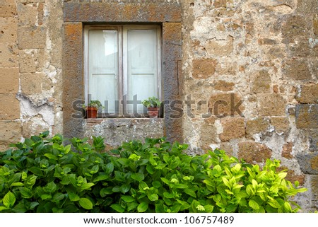 vintage  wall background with old window - stock photo