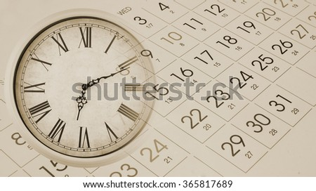 Vintage wall clock and calendar, time concept - stock photo