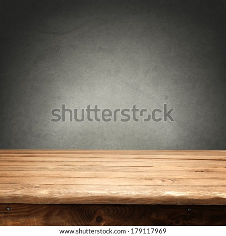 Vintage wall of gray and desk  - stock photo