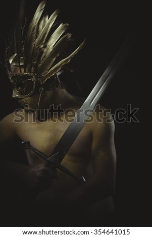 vintage warrior helmet and gold feathers, giant iron sword - stock photo