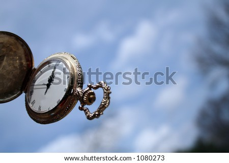 Vintage watch and sky
