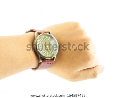 Vintage watch in wrist - A hand wearing a black wrist watch - stock photo