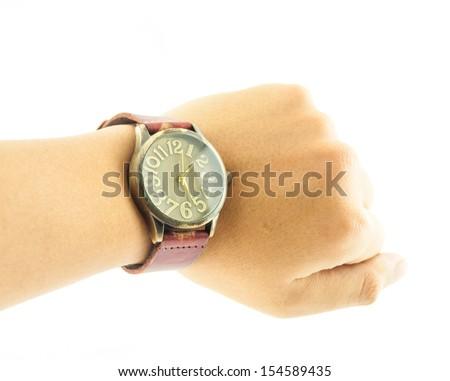 Vintage watch in wrist - A hand wearing a black wrist watch - stock photo