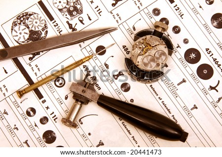 Vintage watch movement with watchmaker's tools. - stock photo