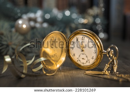 Vintage watch on a festive background showing five to twelve, toned image  - stock photo