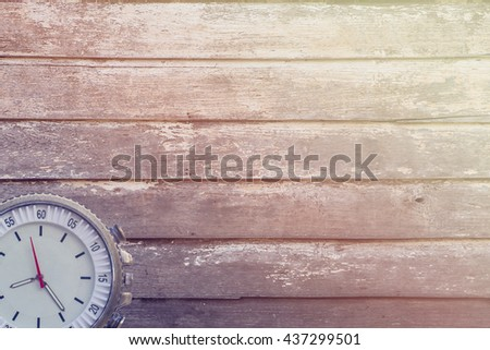 Vintage watch on wooden background / vintage tone style