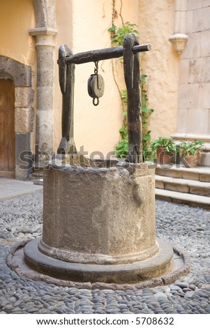 Vintage water well in a medieval village in Spain