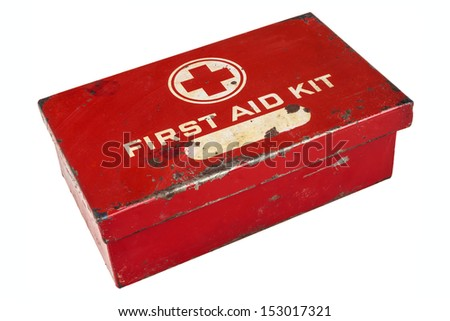 Vintage weathered first aid kit isolated on a white background - stock photo