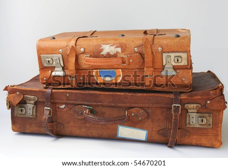 Vintage weathered leather suitcases on top of each other - stock photo