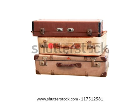 Vintage weathered leather suitcases on top of each other with paths