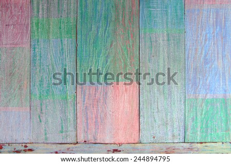 Vintage weathered wood background painted in pastel colors.  - stock photo