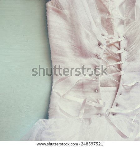 Vintage wedding dress corset background. wedding concept. filtered image - stock photo