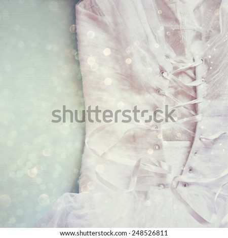 Vintage wedding dress corset background with glitter overlay. wedding concept. filtered image - stock photo