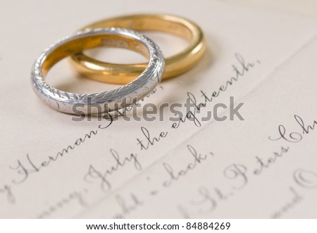 Vintage Wedding Invitation and Rings - stock photo