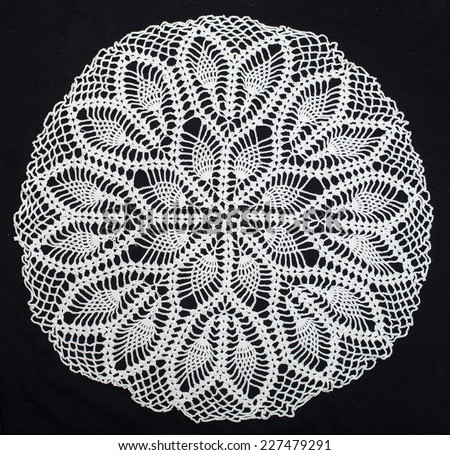 Vintage white knitted napkin isolated on a black background  - stock photo