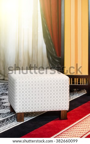 Vintage white pouffe in the living room - stock photo