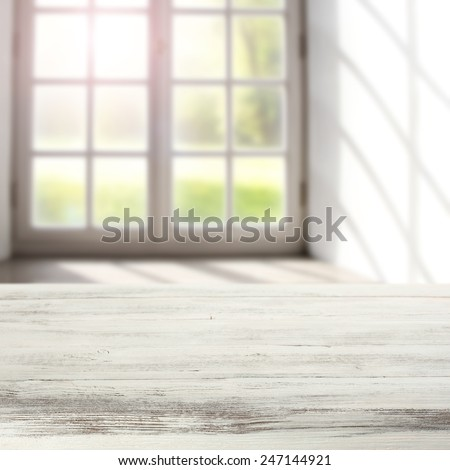 vintage white table top of free space and background of window  - stock photo