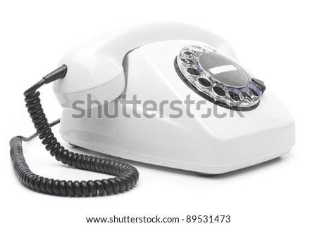 vintage white telephone isolated over white background - stock photo