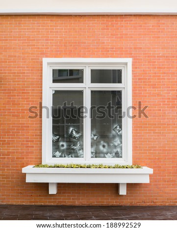 Vintage white window frame on orange brick wall