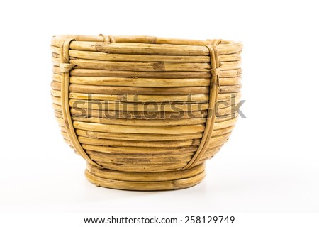 Vintage wicker basket with spiral weave on white background.  Thick round cane material.  Southwestern Native American pattern. - stock photo