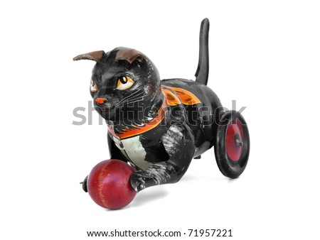 Vintage wind-up tin cat toy with red ball - stock photo