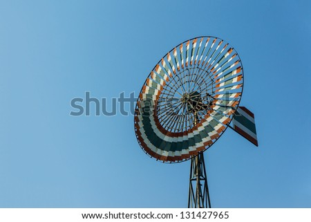 Vintage windmill against blue sky in Thailand