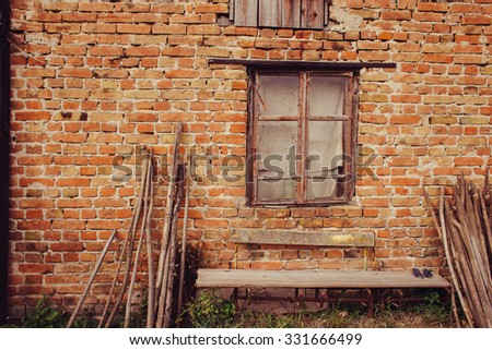 vintage window at the old wall - stock photo