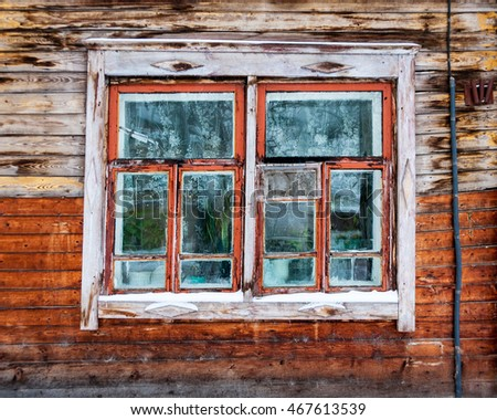 Vintage window - detail of old wooden house in Tomsk, Siberia, Russia
