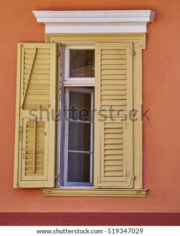 vintage window house on colorful wall