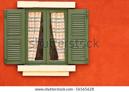 Vintage window on red cement wall - stock photo