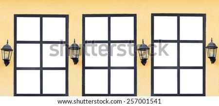 vintage window on yellow wall background  - stock photo