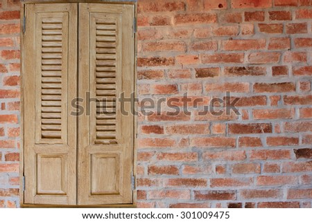Vintage windows on the brick wall. - stock photo