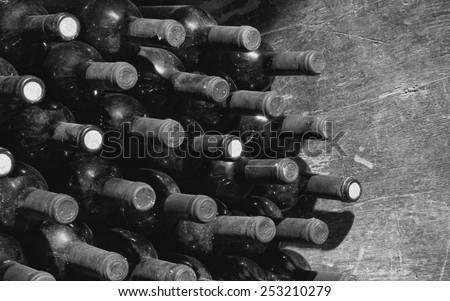 Vintage wine bottles in cellar - stock photo
