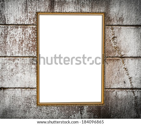 vintage  with empty retro frame on the wall - stock photo