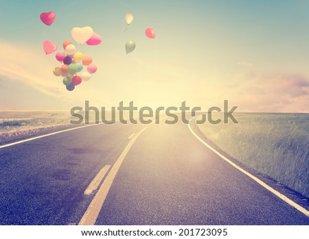 vintage with heart balloon on beach blue sky concept of love in summer and wedding - stock photo