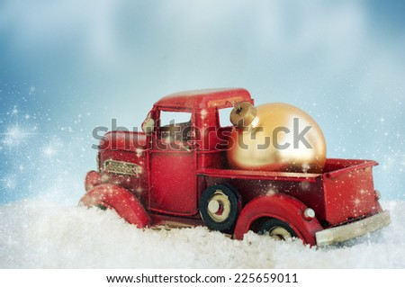 Vintage with red truck with christmas decoration - stock photo