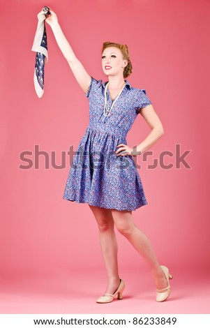 Vintage woman waving goodbye on a pink background - stock photo