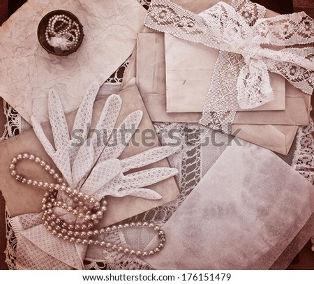 Vintage women's jewelry and gloves. Bundle of old letters with lace ribbon. Monochrome version - stock photo