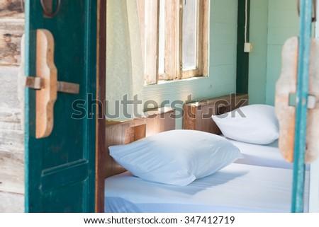 vintage wood bed - stock photo
