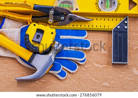 Vintage wood board with variation of construction tools maintenance concept  - stock photo